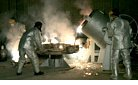 Iran-Technicians work inside Iranian uranium conversion facility.jpg