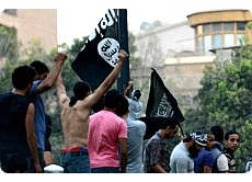Egyptian Islamists fly black flag over US Embassy.jpg