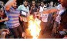 Egyptian protestors burn American flag.jpg