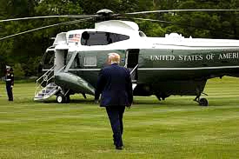 Trump onto helicopter