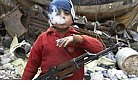 Syrian 7-yr old w/rifle.jpg