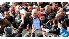 Tunis-Rachid Ghannouchi is swarmed by supporters.jpg