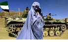 Burqa-wearing woman passes Afghan soldiers.jpg