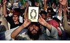Afghan protestors hold up Koran.jpg