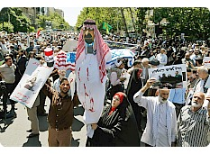 Iranians hold up effigy of Saudi king.jpg