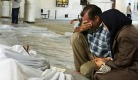 Syrian families mourn.jpg