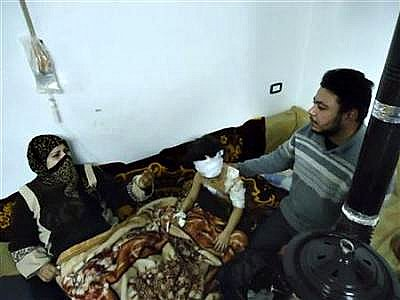 Syria-wounded girl w/parents #1(a).jpg